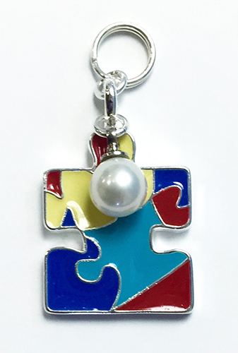 A piece of our Autism Awareness Collection with a white pearl.
